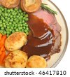 Roast beef dinner with Yorkshire pudding and gravy. - stock photo
