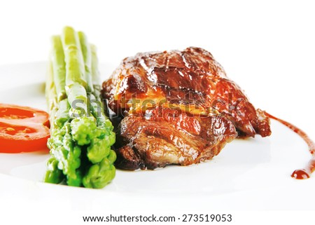 Roasted Beef Served With Asparagus On White Dish