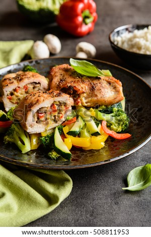 Roasted chicken breasts stuffed with mushrooms, green onion, pepper ...