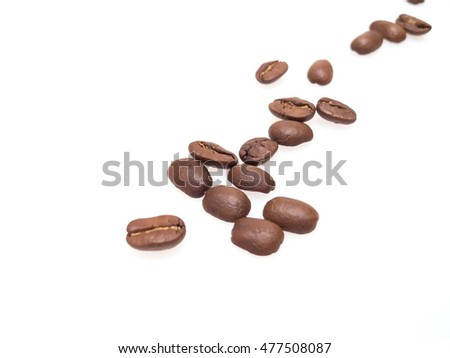 Roasted coffee beans on a white background.