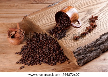 Roasted coffee beans on a wooden board.