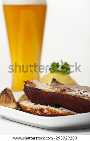 roasted pork with dumpling and wheat beer