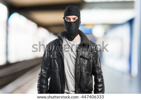 Robber wearing a leather jacket  on unfocused background