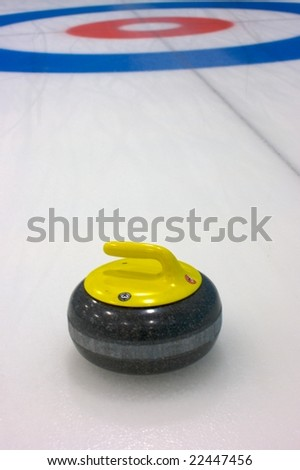 Rock draws to the button on the curling ice