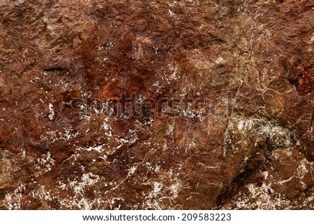 Rock texture and surface background. Cracked and weathered natural stone background.