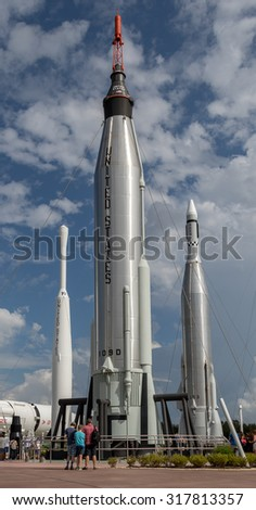 Rocket garden at Cape Canaveral, Kennedy Space Center with blue cloudy sky background. Elements of this image furnished by NASA