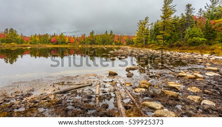 Rocks on the edge of Pearl Lake in the White Mountains of New Hampshire.