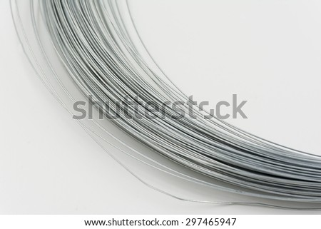 roll of metal wire on white background