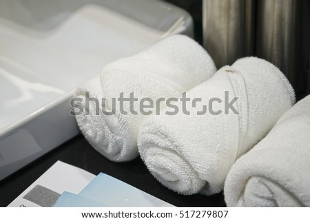 Rolled up white towel in Bathroom.