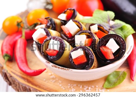rolls of eggplant with tomatoes and goat cheese