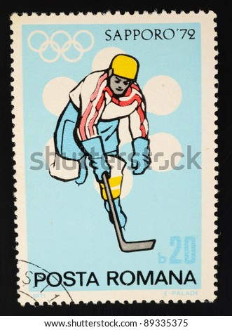 ROMANIA - CIRCA 1972: A stamp from Romania shows image of an ice hockey player and commemorates the 1972 Sapporo Winter Olympics, circa 1972