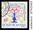 ROMANIA - CIRCA 1966: stamp printed by Romania, shows Pawn and emblem, Chess Olympiad in Cuba in 1966 series, circa 1966 - stock photo
