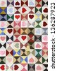 Romantic beautiful colorful heart motif quilt blanket. - stock photo