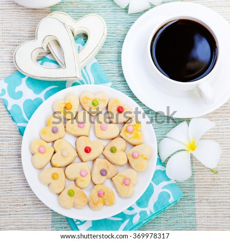 Romantic breakfast concept Cup of coffee with sugar icing decorated heart shaped cookies. Cheerful romantic morning  Top view
