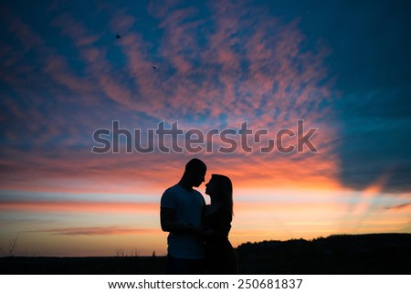 Romantic couple and summer sunset
