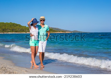 Romantic couple at tropical beach during summer vacation