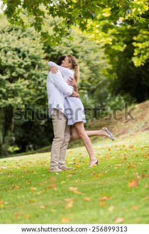 romantic couple hugging at the park