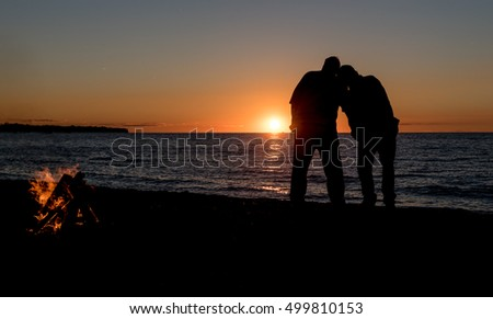 Romantic Couple on the Beach at Sunset