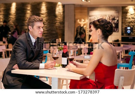 Romantic couple talking in restaurant