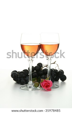 romantic evening, glasses of wine, grappes and rose isolated on white background
