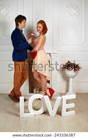 Romantic meeting of the young man and beautiful girl