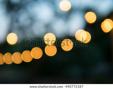 romantic offfocused decorative outdoor christmas string lights in the evening - Decorative String Lights