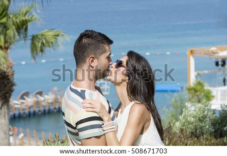 Romantic young  couple hugging at the beach.Summer holiday