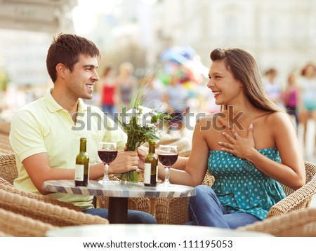 Romantic young couple in a cafe