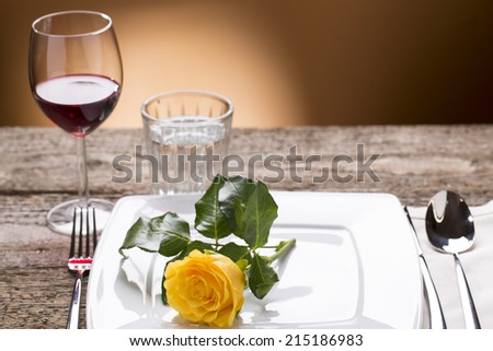 romantically laid table with yellow roses and wine, romantic atmosphere