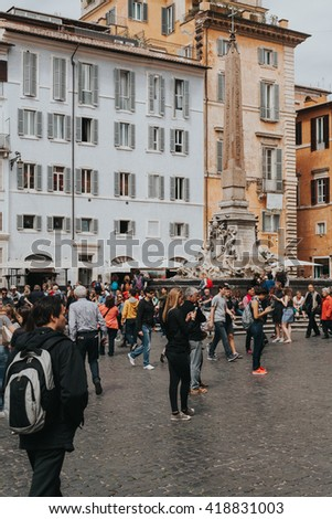 ROME, ITALY - APRIL 22 2016: View of Piazza della Rotonda with tourists walking around on April 22, 2016 in Rome, Italy.