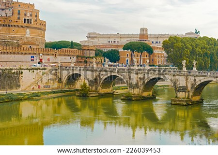 Rome, Italy - August 31, 2014: Tourists walking over St. Angelo Bridge in Rome.  Pedestrian bridge, built in 134AD with travertine marble fascias and spanning the River Tiber