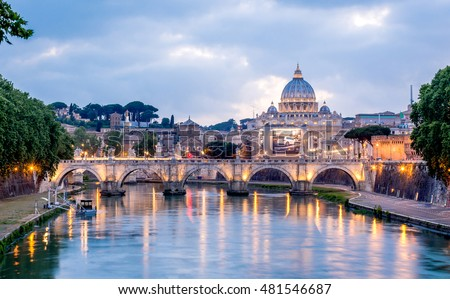 ROME, ITALY - CIRCA MAY 2016 - Rome and Vatican, cityscape, with St peter's basilica and bridge over the river Tiber, on cloudy evening