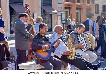 ROME, ITALY - CIRCA OCTOBER 2007: Small band playing in a square