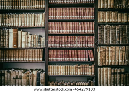 ROME, ITALY - JULY 18, 2016: Shelves with very old books and volumes