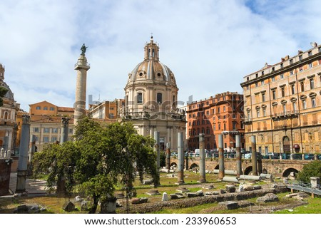 ROME, ITALY - MAY 04, 2014: Ruins of the Forum of Trajan on background of the church Holy Name of Mary and of Trajan's Column in Rome, Italy
