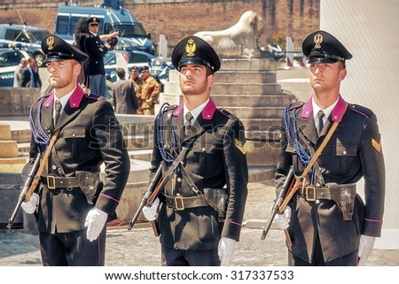 Rome, Italy - May 25, 2012: Three men wearing the uniform history of the State Police, with the armament vintage original, during the celebrations of the 160th anniversary in Piazza del Popolo.