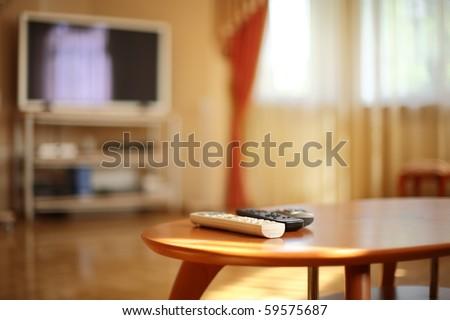 remote control table media tv remote control on blue stock photo 77067565 shutterstock