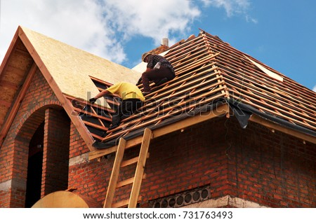 Marvelous Roofing Contractors Installing House Roof Board For Asphalt Shingles.  Roofing Contractor. Roofing Construction.