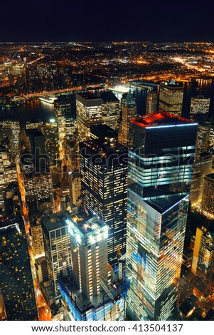 Rooftop night view of New York City downtown with urban skyscrapers