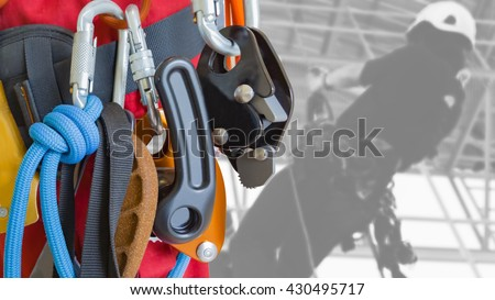 Rope access equipment on inspector man background