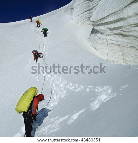 Roped team descending the icefall. Kuylu mountains, Central Tien-Shan, Kyrgyzstan.