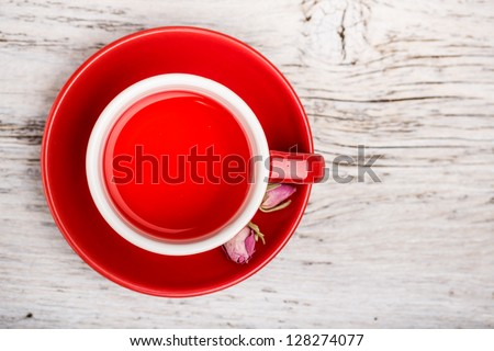Rose bud tea in red cup, above shot