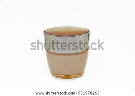 Rose gold bottle with grey lid isolated on white background