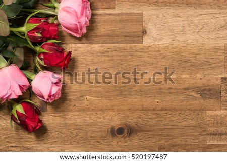 Roses  on wooden background. Valentines day background