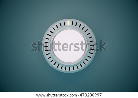 Rotating silver knob button on grey background. 3D Rendering