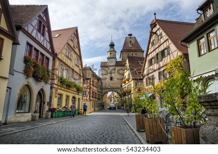 ROTHENBURG OB DER TAUBER, GERMANY - OCTOBER 18, 2016: The Markus Tower (Markusturm) and old buildings on the Rodergasse street.