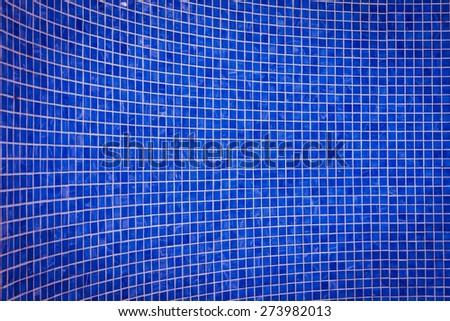 rough blue mosaic tile wall in bathroom