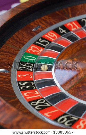 Roulette wheel stopping and ball landing on black 26