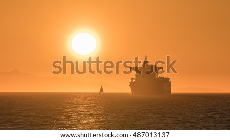 round and bright sunset on the ocean