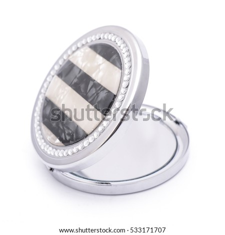 round pocket mirror with diamonds isolated on white